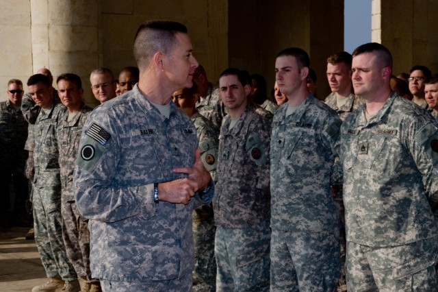 Brig. Gen. Peter Bayer (left), Multi-National Corps-Iraq chief of staff, talks to Soldiers of the Multi-National Corps-Iraq Corps Analyst and Control Element  during an end-of-tour award ceremony Nov. 20, at Camp Victory's Al Faw Palace in Baghdad. Bayer congratulated the Soldiers on a job well done during their 12-month deployment.