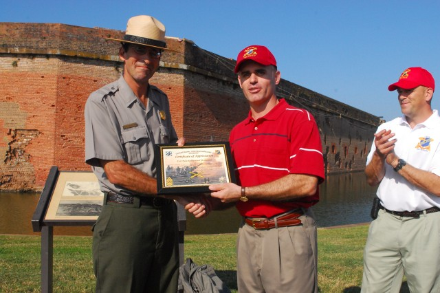 Lieutenant Colonel Ryan LaPorte (left), 1/76 FA commander, awards Mike Weinstein, Fort Pulaski National Monument Park Ranger, a certificate of appreciation, during the Patriot Battalion's second staff ride, Nov. 20, as 1st Sgt. Jack Glasscock, 1/76 FA acting command sergeant major, looks on. The field artillery battalion applied lessons learned from the 1862 Battle of Fort Pulaski, Ga., to today's era of persistent conflict.
