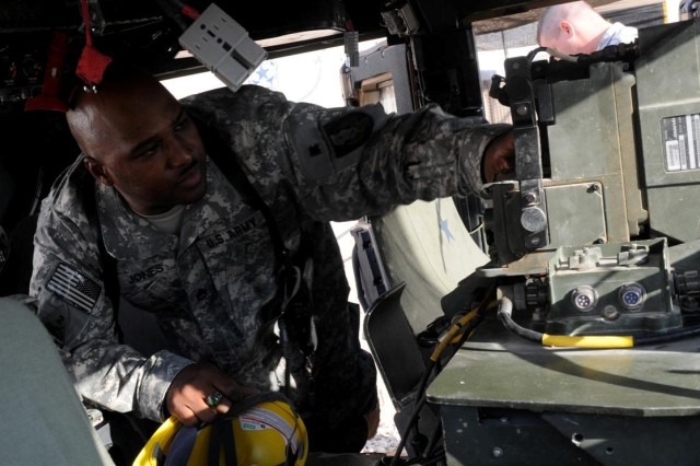 Staff Sgt. McArthur W. Jones Jr., noncommissioned officer in charge of the Personal Security Detachment, with the 36th Sustainment Brigade out of Temple, Texas, and a Fort Worth, Texas, native, inspects a Humvee prior to a mission Nov. 23 in the maintenance yard at Contingency Operating Location Adder, Iraq.