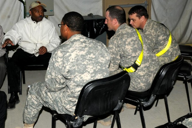 Illinois Sen. Roland W. Burris, a Centralia, Ill., native, speaks to Illinois Soldiers Nov. 24th at Memorial Hall at Contingency Operating Location Adder, Iraq.