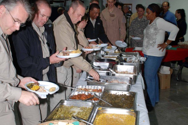 Gulf Region District employees enjoying a traditional Thanksgiving meal at headquarters.
