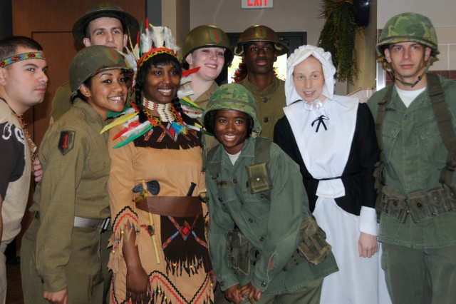 """Soldiers and food service personnel with the Combat Aviation Brigade's dining facility displayed their holiday spirit by dressing in periodic and festive costumes during the CAB's Thanksgiving celebration themed, """"Thanksgiving Feast of History,"""" Nov. 25 at Fort Riley, Kan. More than 750 Soldiers and their Families attended the celebration."""