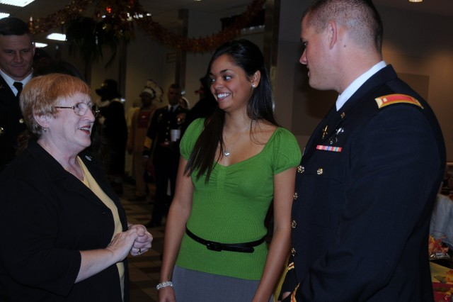 Clay Center, Kan., Mayor Sharon Brown speaks with Amanda Berlin and her husband, 2nd Lt. Joe Berlin, during their Thanksgiving meal Nov. 26 at the Cantigny Dining Facility, Fort Riley, Kan. The Berlins are stationed at Fort Sill, Okla., but were at Fort Riley visiting family for the holiday.