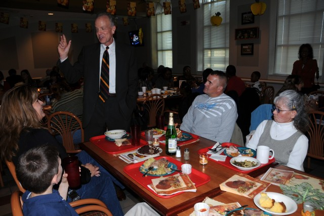 Kansas Congressman Jerry Moran talks with Staff Sgt. Allen Owens, his mother-in-law Mitsuko Vann, his wife Linda Vann-Owens and son, Myles, during their Thanksgiving meal Nov. 26 at the Cantigny Dining Facility at Fort Riley, Kan.