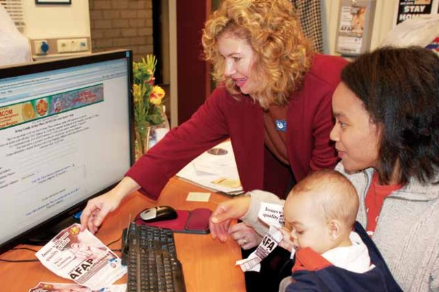 """Jennifer Partridge, USAG Schinnen's AFAP Coordinator, shows AFAP Volunteer, Lyra Kramer and son Jeramie how to submit issues online for the upcoming Tri-Border AFAP Conference, Feb. 3 to 4. Anyone from the Tri-Border military community may submit an issue and/or participate in the conference. For those who can't attend, online issue submission offers an opportunity for their voices to be heard."""""""