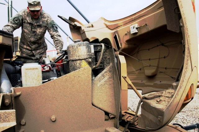 CONTINGENCY OPERATING LOCATION Q-WEST, Iraq - Spc. David W. Dominey, a native of Biloxi, Miss., and gunner with 1st Platoon, A Company, 106th Brigade Support Battalion, out of Magee, Miss., checks under the hood of his Mine-Resistant, Ambush-Protected gun truck during a pre-mission inspection in the company motor pool at Contingency Operating Location Q-West Nov. 21. A convoy security unit, A Co., 106th BSB, is attached to 2nd Battalion, 198th Combined Arms, out of Senatobia, Miss.