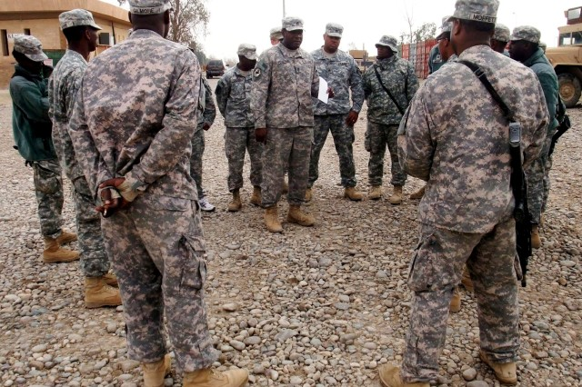 CONTINGENCY OPERATING LOCATION Q-WEST, Iraq - Sgt. 1st Class Kenley E. Feazell (with briefing notes in hand), a platoon sergeant from New Hebron, Miss., briefs his Soldiers in the company motor pool before a mission Nov. 21. All are members of 1st Platoon, A Company, 106th Brigade Support Battalion out of Magee, Miss., a convoy security unit attached to 2nd Battalion, 198th Combined Arms, out of Senatobia, Miss.