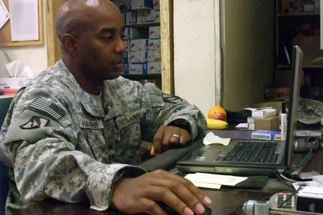 CONTINGENCY OPERATING LOCATION Q-WEST, Iraq - Sgt. Ernest D. Harper, a supply clerk from Prentiss, Miss., orders supplies for convoy missions Nov. 21 in the headquarters area of A Company, 106th Brigade Support Battalion, out of Magee, Miss., a convoy security unit attached to 2nd Battalion, 198th Combined Arms, out of Senatobia, Miss. Harper helps maintain a property book of equipment worth more than 60 million dollars.