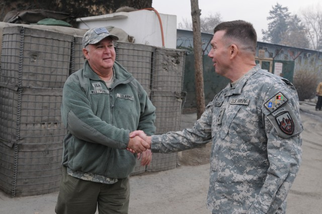 Army Under Secretary Joseph Westphal, left, says goodbye to Lt. Gen William B. Caldwell IV, commander NATO Training Mission-Afghanistan, after a breakfast meeting with senior military leaders on Camp Eggers in Kabul, Afghanistan, a day after Thanksgiving.