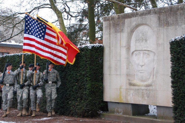BASTOGNE, Belgium -- The U.S. Army Garrison Benelux color guard approaches the Patton Monument Dec. 13 in Bastogne during the 2008 Battle of the Bulge Parade, commemorating the Veterans of the World War II battle.