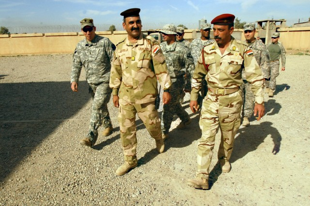 Command Sergeants Major Jeffery Hof (left), Nasser Abed Al Hassen (middle), and Waleed Ibrahim Ismael (right), the 2nd Brigade Combat Team, 1st Cavalry Division, 12th Iraqi Army Division, and the 15th Iraqi Army Brigade top enlisted Soldiers, conduct a battlefield circulation in mid-November.