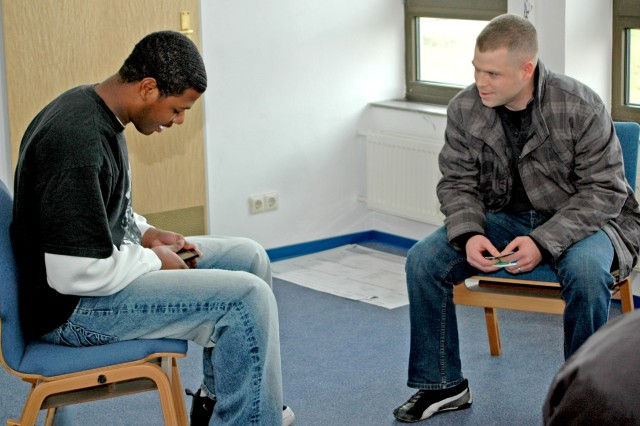 Sgt. Darnell Gasque (left) and Sgt. Nicholas Dyer role play a scenario of a Soldier contemplating suicide because of financial problems.
