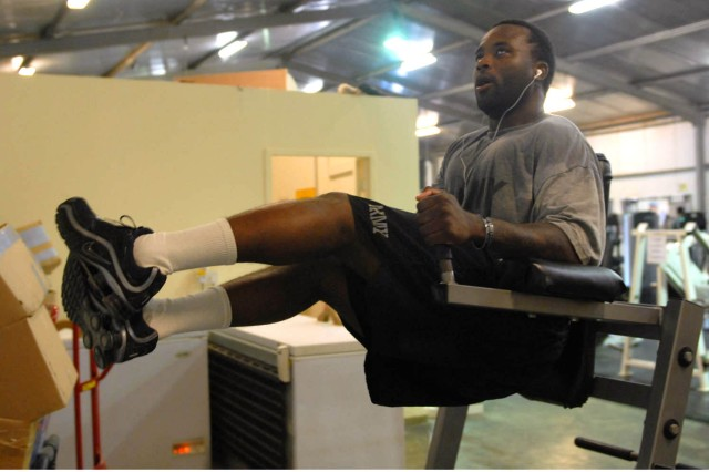"""CAMP TAJI, Iraq - Miami native, Sgt. Herman Johnson, a tanker assigned to Company D, 2nd Battalion, 8th Cavalry Regiment, 1st Brigade Combat Team, 1st Cavalry Division, performs the leg lifts designed to strengthen the abdominal area, during a workout at the Air Cavalry Gymnasium on Camp Taji, Nov. 24. """"Keeping our physical fitness standards up while deployed is very important,"""" Johnson said. """"So, my Soldiers and I come to the gym everyday and work out."""""""