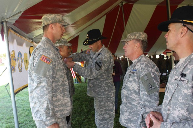 "Col. Brian Winski, 4th Brigade Combat Team, 1st Cavalry Division ""Long Knife"" Commander, pins an Expert Infantry Badge during the EIB Award Ceremony Nov. 23."