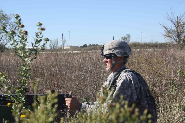 Sgt. Eddie Baker, Company A, 2nd Battalion, 7th Cavalry Regiment, 4th Brigade Combat Team, 1st Cavalry Division, fires a M-60 machine gun during EIB testing. Baker was one of 14 Soldiers who earned their Expert Infantry Badge Nov. 23.
