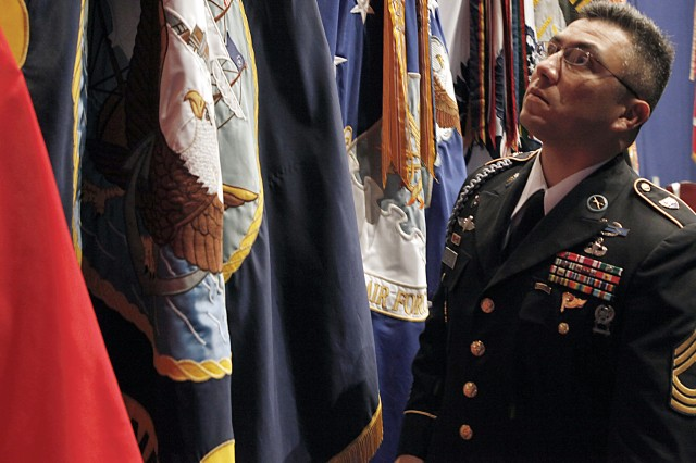 Master Sgt. Santiago Perales, U.S. Military Academy G3 noncommissioned officer-in-charge, inspects a flag display set up at Eisenhower Hall for President Obama's visit to West Point today. Obama is expected to discuss his plans for the troop buildup in Afghanistan later this evening.