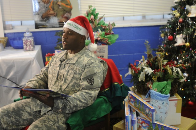 "Command Sgt. Maj. Cedric Thomas reads a Christmas story that will be turned into a video that will be distributed throughout Iraq, Kuwait and Afghanistan to deployed Fort Eustis Soldiers. Along with the video, the USO is sending approximately 1,000 personalized Christmas stockings and a number of care packages to the troops. ""I truly feel anything, be it time or gifts, is successful, knowing that the community remembers you is crucial for morale,"" said Mary Moyer, Fort Eustis Center Director, USO, on the importance of remembering deployed Soldiers during the holiday season. (US Army photo by Sgt. 1st Class Kelly Jo Bridgwater)"