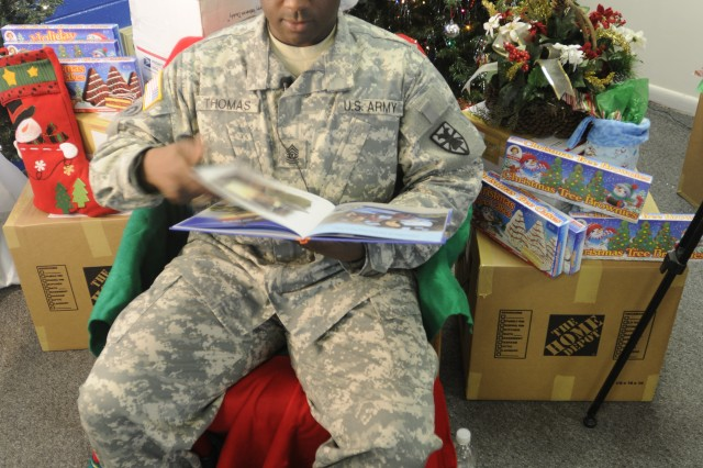 Command Sgt. Maj. Cedric Thomas reads a Christmas story that will be turned into a video that will be distributed throughout Iraq, Kuwait and Afghanistan to deployed Fort Eustis Soldiers. (US Army photo by Sgt. 1st Class Kelly Jo Bridgwater)