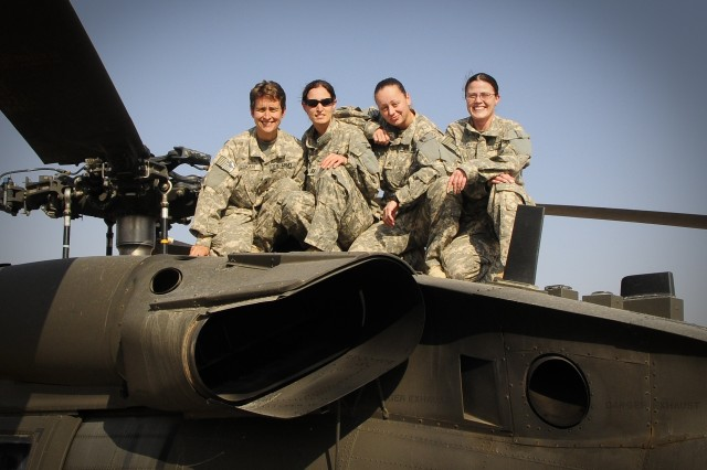 "From left to right: Sgt. Debra Lukan, Capt. Trish Barker, Staff Sgt. Misty Seward and Chief Warrant Officer Andrea Galatian of ""C"" Company, 3-238th MEDEVAC, became the company's first all-female crew just before Thanksgiving. They are currently serving in Iraq as part of Task Force Keystone."