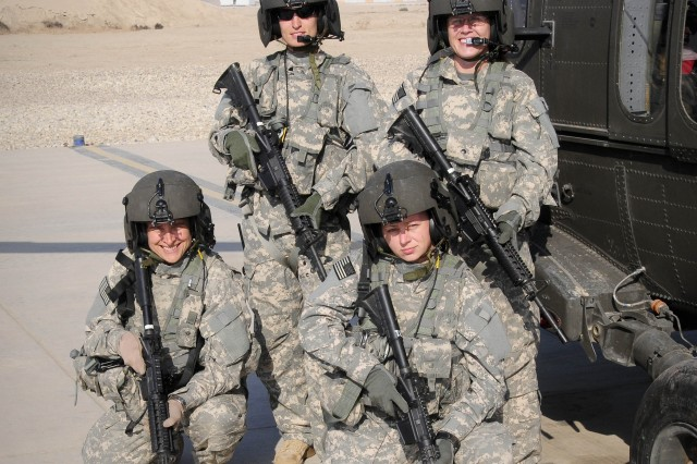 "Clockwise from top left: Capt. Trish Barker, Chief Warrant Officer Andrea Galatian, Staff Sgt. Misty Seward and Sgt. Debra Lukan of ""C"" Company, 3-238th MEDEVAC, became the unit's first all-female crew just before Thanksgiving. They are currently serving in Iraq as part of Task Force Keystone."