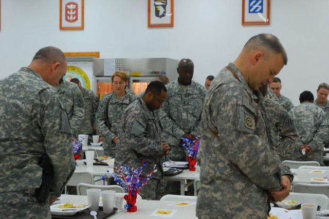Soldiers from FOB Marez, Iraq, come together through prayer during a prayer luncheon held at FOB Marez, Nov. 20.