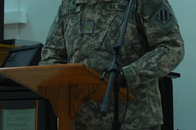 Chaplain (Maj.) Sid Taylor, 2nd HBCT, 3rd ID says a prayer during a prayer luncheon held at FOB Marez, Iraq, Nov. 20.