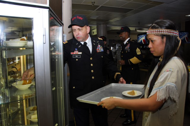 Lt. Col. George Cox, 101st Combat Aviation Brigade deputy commander helps Pfc. Loyola Jensen, a chef with Headquarters and Headquarters Company, 96th Aviation Support Battalion, 101st CAB restock the pie cooler at the Son Café Dining Facility's Thanksgiving meal, Fort Campbell, Ky. Nov. 24. The Dining Facility provided a Thanksgiving feast for all of the 101st CAB Soldiers and their Families. The early Thanksgiving meal allowed all Soldiers the opportunity to travel safely home for the holidays and still enjoy holiday time with their 101st CAB family.  PHOTOS BY SADIE BLEISTEIN, 101st CAB PAO.  http://www.flickr.com/photos/wingsofdestiny/ http://www.facebook.com/101CAB