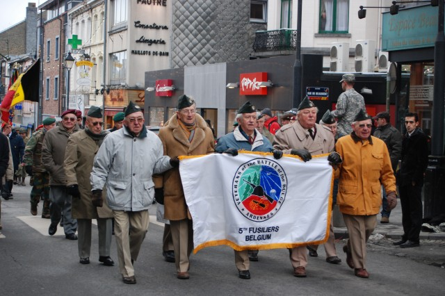 Veterans of the 5th Belgian Fusiliers Battalion march down the streets of Bastogne, Belgium, in the 2008 Battle of the Bulge Parade.  Marcel D'Haese (center) is the chairman of the 5th Fusilier War Veterans Association and Robert Lemaire (far right) is a longtime member.