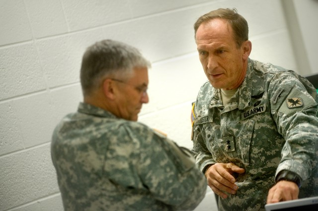 Maj. Gen. John Custer, commanding general of the Army's Intelligence Center and Fort Huachuca, briefs Gen. George W. Casey Jr., chief of staff of the Army, about new technologies at the school for military intelligence in Fort Huachuca, Ariz., Dec. 1, 2009.