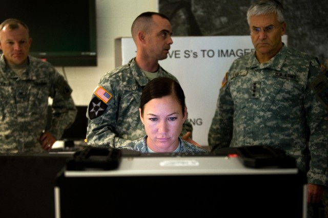 Chief of Staff of the Army Gen. George W. Casey Jr. is given a demonstration on the training being done at the United States Army Intelligence Center in Fort Huachuca, Ariz., Dec. 1, 2009.