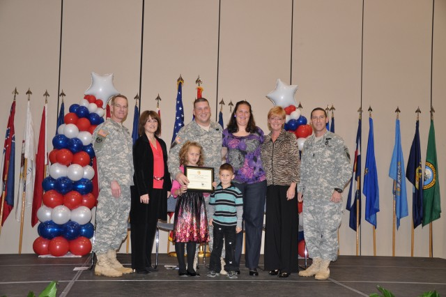 Each nominated family was honored by Brig. Gen. Bradley May and his wife, Jan, and Command Sgt. Maj. Brian Stall and his wife, Cheryl. Nominee: Sgt. 1st Class Wayne and Amy Scarpulla, Ariana (7), Angelo (4)