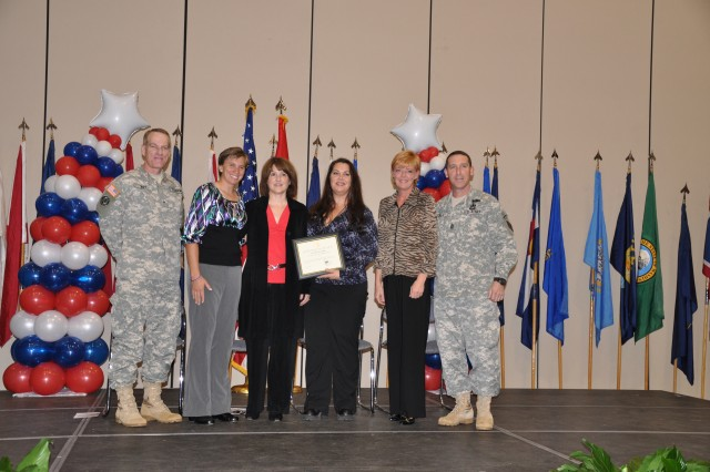 Each nominated family was honored by Brig. Gen. Bradley May and his wife, Jan, and Command Sgt. Maj. Brian Stall and his wife, Cheryl.  Nominee: Monica and 1st Sgt. Joe Duvernay (not pictured) and Dawn Deslatte