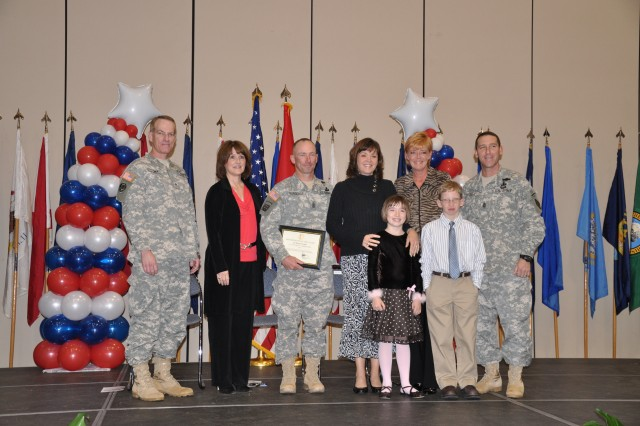 Each nominated family was honored by Brig. Gen. Bradley May and his wife, Jan, along with Command Sgt. Maj. Brian Stall and his wife, Cheryl. Nominee: 1st Sgt. Cliff and Kate Burgoyne, Trey (10), Chandler (8).