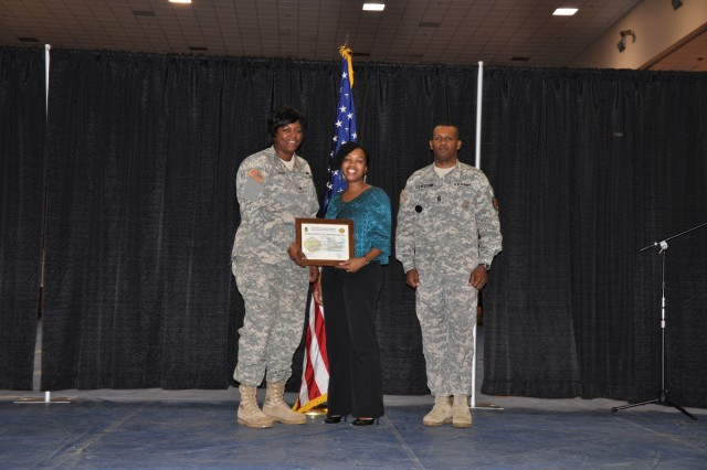 The employees of the month were awarded by Col. Lillian Dixon, garrison commander, and garrison Command Sgt. Maj. Christopher Culbertson.  Pictured: Crystal Brown; Public Affairs Office