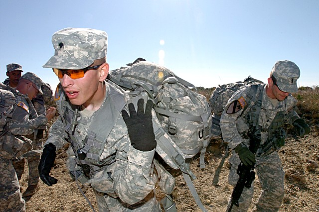 Spc. George Warren, of Santa Cruz, Calif., and his team, put on their rucksacks and head off to their next point Nov. 24, during the 2nd Battalion, 12th Cavalry Regiment's Spur Ride.