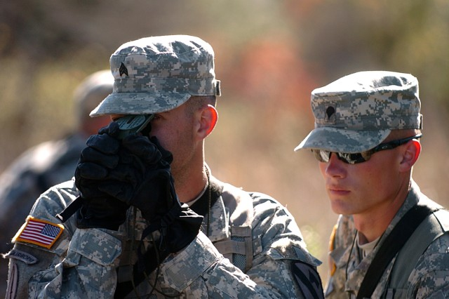 Sgt. Nathaniel Oawster (left), of Branson, Mo., and Spc. Craig Rion, of Omaha, Neb., navigate their team's next point Nov. 24, during the 2nd Battalion, 12th Cavalry Regiment's Spur Ride