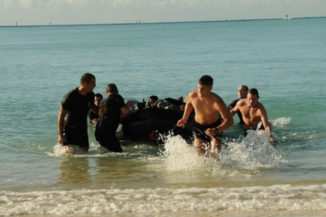 Soldiers from the 7th Engineer Dive Team (EDT) carry the Zodiac seacraft from the ocean during the 7th EDT Commander's Cup Challenge Nov. 10 at Hickam Air Force Base, Hawaii.