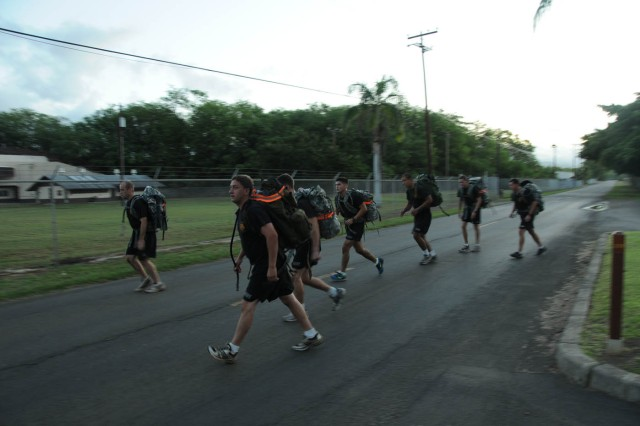 Soldiers from the 7th Engineer Dive Team ruck march during the 7th EDT Commander's Cup Challenge Nov. 10 at Hickam Air Force Base, Hawaii.
