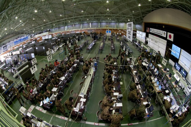 CAMP HIGASHI-CHITOSE, Japan (Dec. 3, 2009)- An aerial view of the combined operations/intelligence center, manned by the Northern Army of the Japan Ground Self-Defense Force, Contingency Command Post of United States Army, Pacific and I Corps Forward during the early stages of Exercise Yama Sakura 57. Since its inception in 1982, Yama Sakura has focused on the development and refinement of the JGSDF and U.S. Army, Japan efforts in the areas of bilateral planning, coordination and interoperability through training. (photo by U.S. Army Sgt. Gerardo DeAvila, 124th Mobile Public Affairs Detachment)