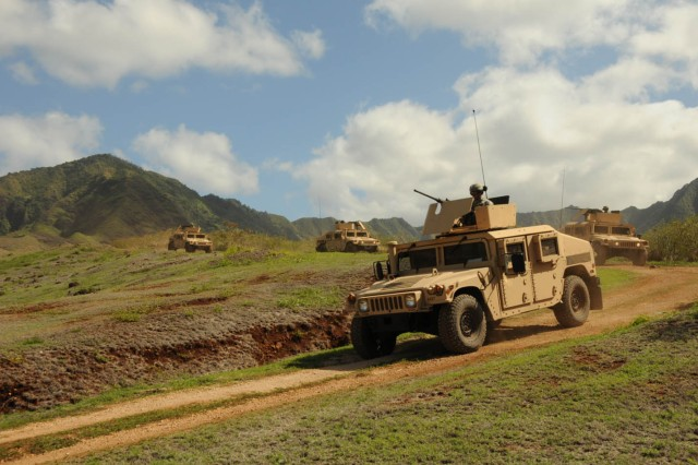 Soldiers from the 225th Brigade Support Battalion travel down the dirt roads and hills searching for possible [simulated] road side bombs during a field training exercise Nov. 18 at Makua Valley, on the island of O'ahu.
