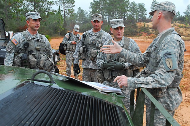 Capt. Matthew Myer, C Company commander, briefs Maj. Gen. Michael Ferriter, commanding general of Fort Benning, Ga., on the 10-day field training exercise students undergo in the swamp phase.