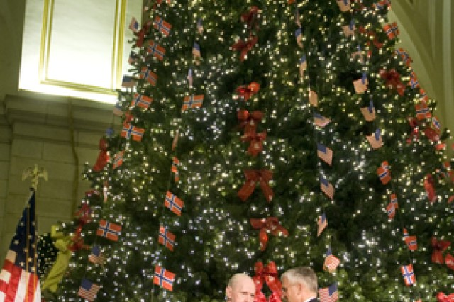 Jarvis Taylor, World War II veteran of the 99th Infantry Battalion, talks with Chief of Staff of the Army, Gen. George W. Casey Jr. at the conclusion of the 13th annual Norwegian Tree Lighting Ceremony in Union Station, Washington D.C., Dec. 3. This year's theme honors the Norwegian and Americans of the 99th Infantry Battalion who fought at the Battle of the Bulge and freed 52 Americans at Malmedy.