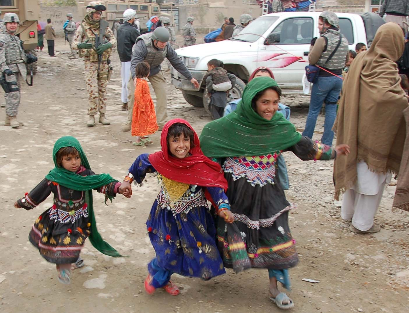 Young Afghan girls, excited by the arrival of