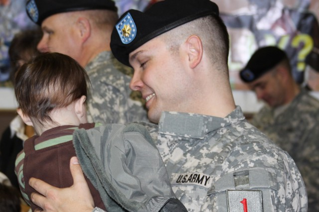 Maj. David Oakley shares a moment with his son, Tyler, following the deployment ceremony for the 1st Infantry Division's Headquarters and Headquarter Battalion.
