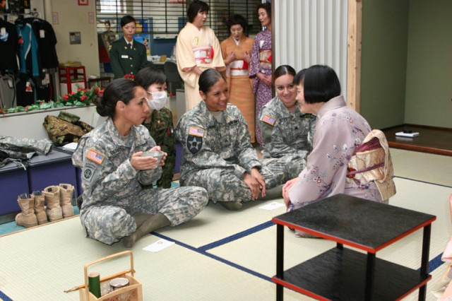 CAMP HIGASHI-CHITOSE, Japan (Dec. 5, 2009) - Sgt. Johanna Zamora, (left), 196th Infantry Brigade, Fort Shafter, Hawaii, and Sgt. Lizeth Reyes, Headquarters Company, 40th Infantry Division from Los Angeles, participate in a traditional Japanese tea ceremony. These ceremonies were offered as part of the cultural awareness series during Exercise Yama Sakura 57, an annual bilateral exercise between the Japan Ground Self-Defense Force and U.S. Army. (Photo by U.S. Army Pfc. Ashley Fontenot, 124th Mobile Public Affairs Detachment)