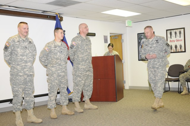 Col. Greg Bowen, commander of the 100th Missile Defense Brigade (GMD), addresses the leadership lineup of his Headquarters and Headquarters Battery during the Change of Responsibility ceremony Dec. 4.  Incoming 1st Sgt. William Ray, (l), battery commander Capt. George Lambos, and outgoing 1st Sgt. William Jewell, listen intently.