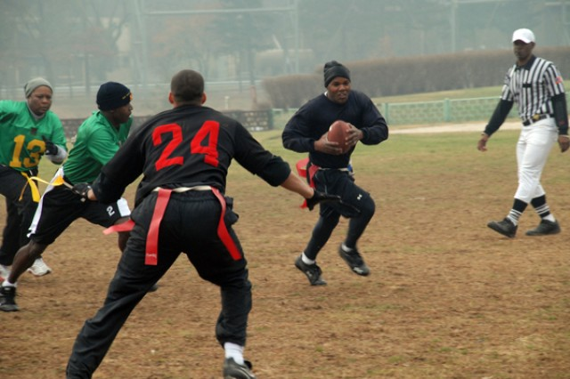 After throwing a touchdown and another pass for the two point conversion by Harris, the NCO's were showing signs of a comeback with the score 20-8. Calvin and the Officer team threw a late interception, which resulted in Dunbar scoring but was unable to convert for two additional points leaving the score to 20-14.