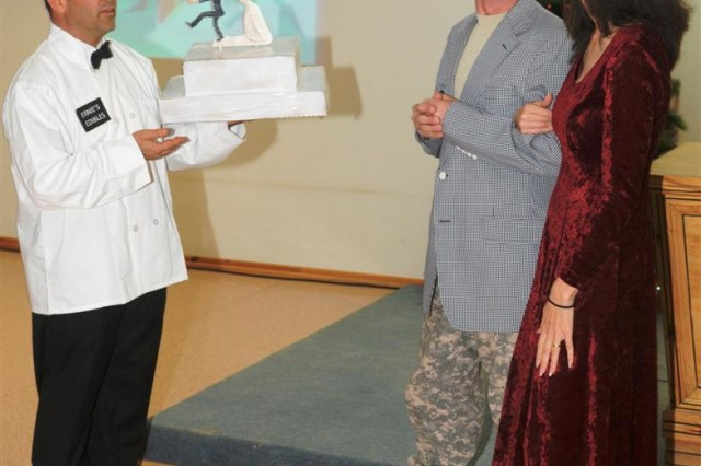 """Sgt. Andrew J. Schneiders, command executive assistant with Task Force 38 and a Mooresville, Ind., native, and Capt. Christina Shepard, logistics officer with TF 38 and Clayton, Ind., native, act out a scene in the military version of """"It's a Wonderful Life,"""" titled """"It's a Wonderful Deployment."""""""