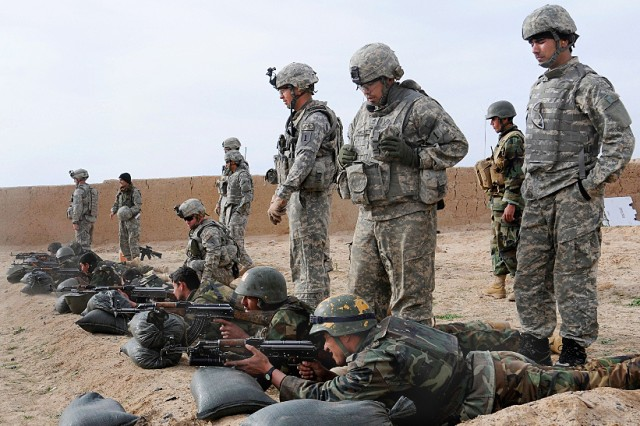 In this file photo, U.S. Army Soldiers look on as Afghan National Army soldiers zero their weapons during basic rifle marksmanship training on Bagram Airfield, Afghanistan, Feb. 11, 2009. The soldiers are assigned to the 1st Infantry Division's, 3rd Brigade Combat Team.