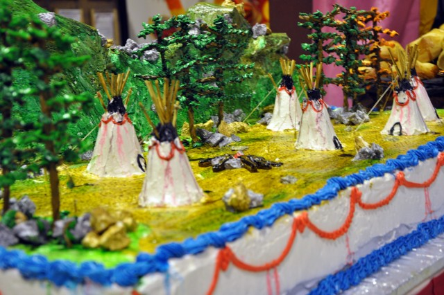 A 3-D cake made by Sixto Jimenez, a San Jose Del Monte, Philippines, native and head baker for the dining facility here, sits on display at Thanksgiving dinner next to a dining facility entrance here, Nov. 26. (U.S. Army photo by Sgt. Matthew C. Cooley, 15th Sustainment Brigade public affairs)